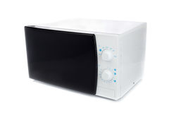 New microwave oven with analog control. Royalty Free Stock Photography