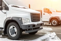 New middle size trucks at dealership parking outdoors at winter. Truck service and maintenance. Delivering and warehouse service royalty free stock photos
