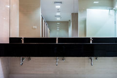 New mirrors and ceramic granite counter washbasins Stock Image
