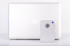The new mobile Thunderbolt Drive for Mac with Macbook Pro. The new mobile thunderbolt drive from G-technology designed for Apple. Seen with the MacbookPro and Stock Image