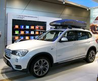 New mode of BMW SUV. New model of BMW SUV with carrier for display to visitors. White color car in sporty design Royalty Free Stock Photo