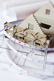 New model house on architecture blueprint plan at desk Stock Photo