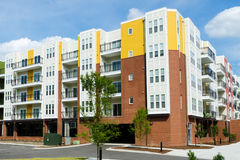 New modern apartment building. Newly constructed apartment building with ground level garage Royalty Free Stock Images
