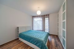 New modern bedroom. New home. Interior photography. Wooden floor. Royalty Free Stock Photos