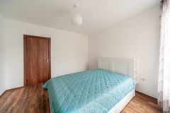 New modern bedroom. New home. Interior photography. Wooden floor. Royalty Free Stock Images