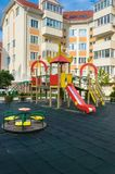 New modern bright children`s playground in the new summer reside. Ntial complex in the summer Royalty Free Stock Photography