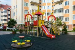 New modern bright children`s playground in the new summer reside. Ntial complex in the summer Stock Photo
