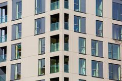 New modern building concept. Contemporary block of flats in hi-tech style royalty free stock photography