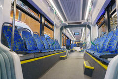 New modern cabin of city transport. With modern blue seats Stock Photos