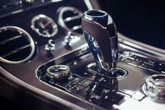 Luxury car interior details. New modern car automatic gearbox gear stick lever royalty free stock images