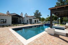 New Modern Classic Home Backyard Pool. New modern desert classic mansion home backyard pool royalty free stock photos