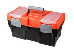 New modern closed toolbox black plastic, with an orange top. Stock Photo