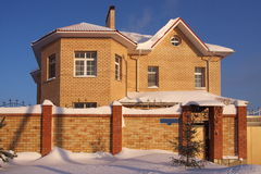 New modern cottage. New beautiful modern cottage in the winter against the blue sky Stock Photo
