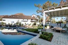 New Modern Classic Home Backyard Patio Plaza. New modern desert classic home with backyard patio in Arizona, USA royalty free stock photography