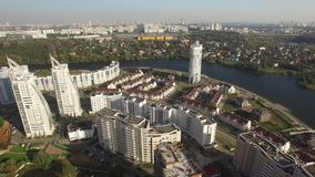 New modern districts city Moscow from above Aerial drone shots. Contemporary mix architecture old new Luxury apartments Russia. Aerial drone. Sunny day. Life stock video footage