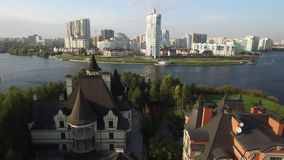 New modern districts of the city of Moscow Contemporary mix architecture old and new. Luxury apartments property in Russia. From above. Aerial drone shots. Sunny stock footage