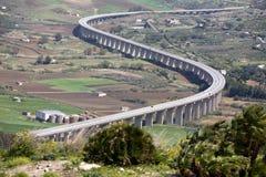 New modern highway, Segesta village, Sicily, Italy. New modern highway winding among green valley, Segesta village, Sicily, Italy Royalty Free Stock Images