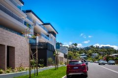 New Modern Holiday Homes at Avoca Beach, Australia. Avoca Beach, Central Coast, Australia - November 12, 2017: Modern buildings on Avoca drive on the seashore at Royalty Free Stock Images