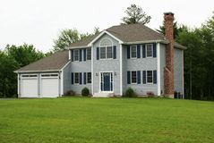 New modern home. New modern colonial home with a 2 car attached garage Royalty Free Stock Photo