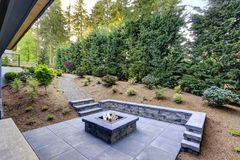 Free New Modern Home Features A Backyard With Fire Pit Stock Photography - 102751892