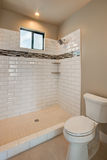 New Modern Home Guest Bathroom. New modern model home bathroom with unique tiled shower royalty free stock photography
