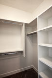 New Modern Home Guest Closet. Brand new modern model home spacious guest closet royalty free stock image