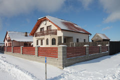 New modern house in village in winter Stock Photography
