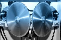 New modern industrial circular saw disks. Blue toned stock image