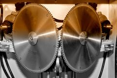 New modern industrial circular saw disks. Brown toned stock photography