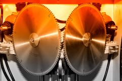 New modern industrial circular saw disks. Red toned royalty free stock images