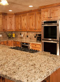 New Modern Kitchen Range and Cabinetry royalty free stock photography