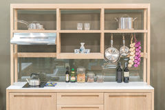 New modern kitchen with wood shelf style.  royalty free stock photos