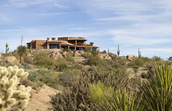 New modern luxury desert golf course home. New modern luxury desert home atop a mountain alongside Arizona golf course Stock Image