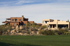 New modern luxury golf course homes. New modern luxury desert homes nestled in the mountains alongside a golf course Royalty Free Stock Image