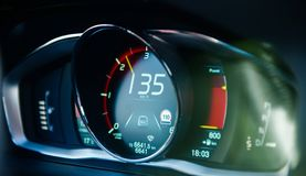 New modern luxury sport car digital dashboard driving data speed. New modern luxury sport car digital dashboard showing 135 kmh speed driving data and current royalty free stock photo