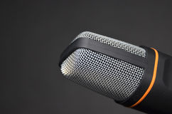 New modern microphone recording device on black background. Royalty Free Stock Image