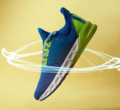 New modern running shoe in light circle Royalty Free Stock Images