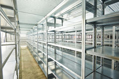 New modern shelves in warehouse. Modern metal warehouse shelves construction indoors Royalty Free Stock Photos