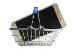 New modern smartphone. In shopping basket isolated on white. Concept buying smartphone stock photography