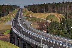 New modern steel motor road bridge on reinforced concrete suppor. Saint Petersburg, Russia - August 7, 2015: Top view of highway bridge in final stage of stock photos