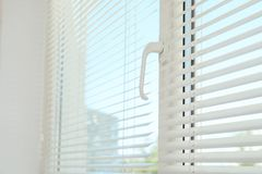 New modern window with blinds indoors. Home interior stock photos