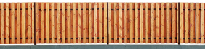 New modern  yellow wooden rural fence from vanished vertical pin Royalty Free Stock Photos