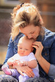 New Mom Holds Young Baby Royalty Free Stock Photo