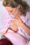 New Mom Nursing Newborn Baby Stock Photography