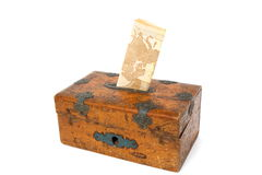 New money in old moneybox Royalty Free Stock Photo