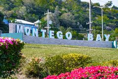 The new Montego Bay sign in Jamaica. The new Montego Bay sign with illuminated lettering at the roundabout on main road outside Sangster International Airport stock photography