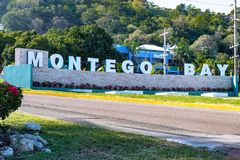 The new Montego Bay sign in Jamaica. The new Montego Bay sign with illuminated lettering at the roundabout on main road outside Sangster International Airport stock image