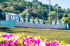 The new Montego Bay sign in Jamaica. The new Montego Bay sign with illuminated lettering at the roundabout on main road outside Sangster International Airport royalty free stock photos