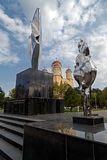 New monument and Orthodox church in Resita, Romania. RESITA, ROMANIA - SEPTEMBER 1, 2016: New monument and Orthodox church in Resita, Romania Royalty Free Stock Photography