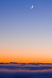 New moon in evening sky Stock Photography